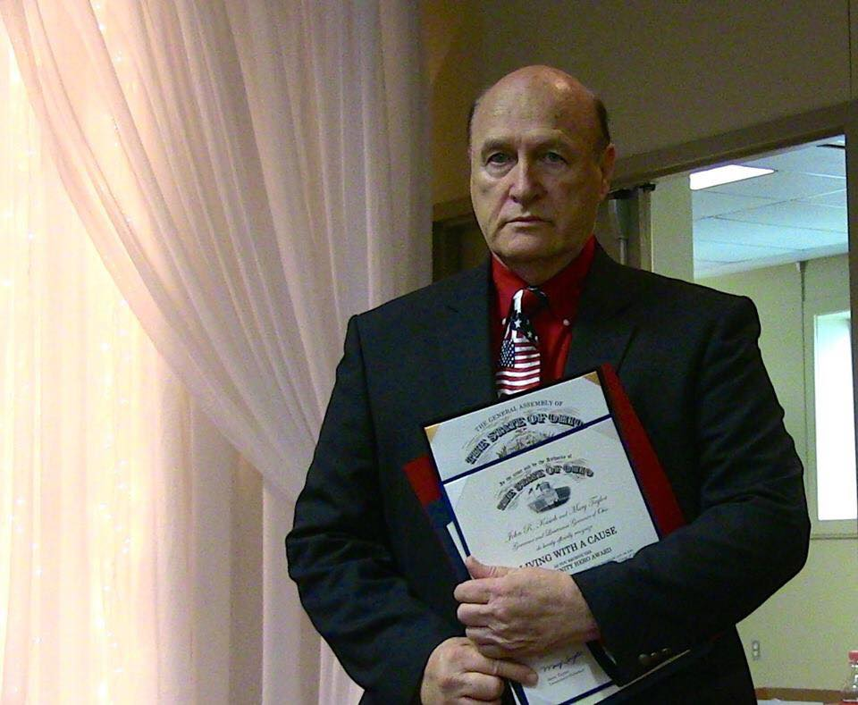 Pastor Mike Gifford with awards