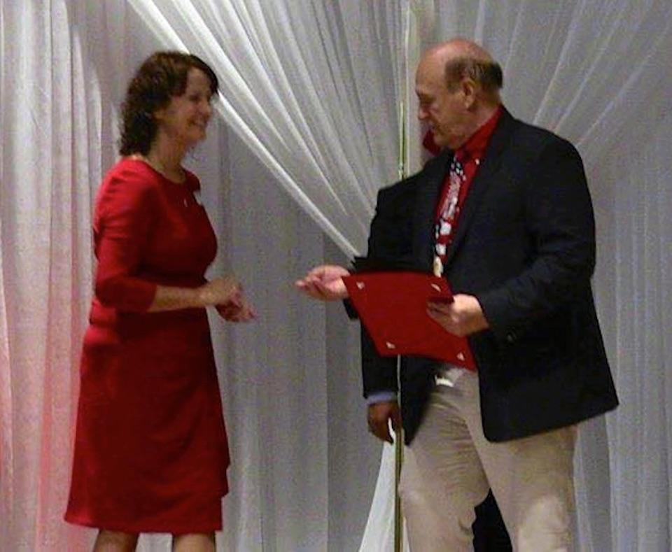 Pastor Mike Gifford receiving an award